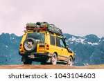 yellow suv car on off road in...