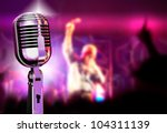 Music background with vintage microphone and concert - stock photo