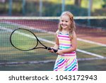 child playing tennis on outdoor ... | Shutterstock . vector #1043172943