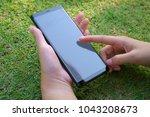 female hand holding the... | Shutterstock . vector #1043208673