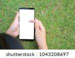 female hand holding the... | Shutterstock . vector #1043208697