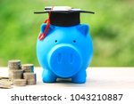 graduation hat on piggy and... | Shutterstock . vector #1043210887
