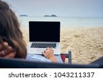 freelancer with laptop on the... | Shutterstock . vector #1043211337