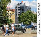 Small photo of People walk in the city. Building of PWC company in Sofia. Insurance, advisory, tax service. Urban cityscape of European cities. Bulgaria, Sofia - June 10, 2017