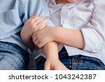 child's hand hugging hand   Shutterstock . vector #1043242387