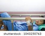 asian boy sleeping on patient... | Shutterstock . vector #1043250763