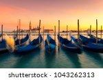 sunset in venice. gondolas at... | Shutterstock . vector #1043262313
