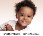 closeup portrait of a cute... | Shutterstock . vector #1043267863