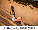 beautiful young woman sitting... | Shutterstock . vector #1043274013