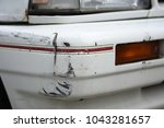 Small photo of Abrasion on the white car parked on the street