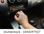 male hand switches automatic... | Shutterstock . vector #1043297527