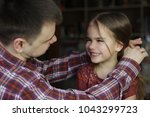 adult father looking with love... | Shutterstock . vector #1043299723