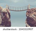 old bridge over between two big ... | Shutterstock . vector #1043310907