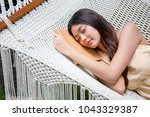 women is sleep on beach cot. | Shutterstock . vector #1043329387