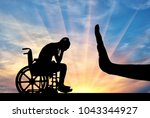 silhouette of sad disabled... | Shutterstock . vector #1043344927