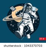 astronaut taking a photo in... | Shutterstock .eps vector #1043370703
