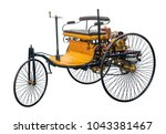 Small photo of replica of a old historic vehicle named patent motorcar isolated in white back