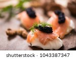 canapes with smoked salmon and... | Shutterstock . vector #1043387347