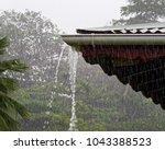 strong tropical rain falls in a ... | Shutterstock . vector #1043388523