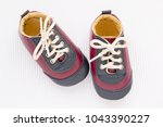 cute little baby shoes on white ... | Shutterstock . vector #1043390227