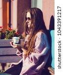 beautiful fashion woman holding ...   Shutterstock . vector #1043391217