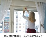 blonde woman measuring and... | Shutterstock . vector #1043396827