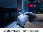 operator working cut and... | Shutterstock . vector #1043407333