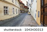 view on the narrow cobblestoned ... | Shutterstock . vector #1043430313