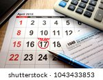calendar on office desk showing ... | Shutterstock . vector #1043433853