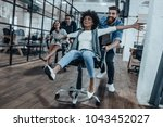 we are the winners   four young ... | Shutterstock . vector #1043452027