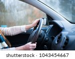 young woman driving her new car ... | Shutterstock . vector #1043454667