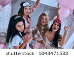 ladies party  top view of four... | Shutterstock . vector #1043471533