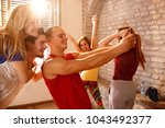 young cheerful dancers on pause ... | Shutterstock . vector #1043492377