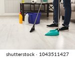 unrecognizable man cleaning... | Shutterstock . vector #1043511427