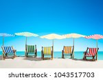 multi colored sun loungers with ... | Shutterstock . vector #1043517703