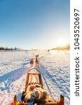 husky dogs are pulling sledge... | Shutterstock . vector #1043520697