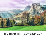 awesome alpine highlands in... | Shutterstock . vector #1043524207