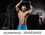 handsome muscular guy in blue... | Shutterstock . vector #1043526403