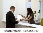 a front desk lady doing her job ... | Shutterstock . vector #104356247