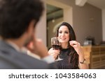 couple having dinner in a... | Shutterstock . vector #1043584063