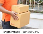 delivery man with parcel. | Shutterstock . vector #1043592547