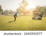 man playing golf. | Shutterstock . vector #1043592577