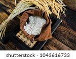 jajasmine rice in sack rice in... | Shutterstock . vector #1043616733