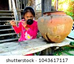 little girl drinking water with ... | Shutterstock . vector #1043617117