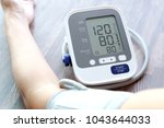 human check blood pressure... | Shutterstock . vector #1043644033