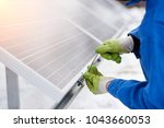 cropped close up of a repairman ... | Shutterstock . vector #1043660053