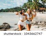two cute beautiful girls in... | Shutterstock . vector #1043662747