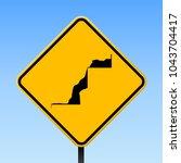 western sahara map road sign.... | Shutterstock .eps vector #1043704417