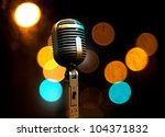 Musical background with microphone and stage lights - stock photo