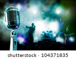 Live music background.Microphone and band - stock photo